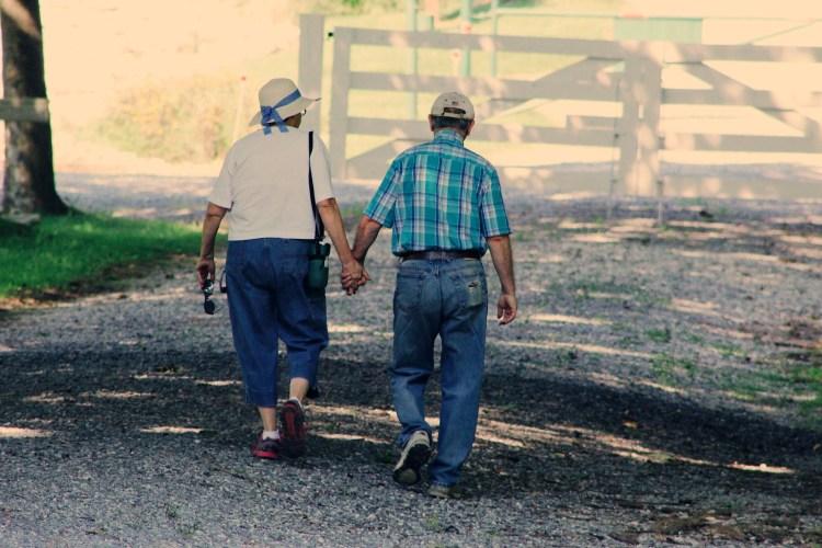 adults-cap-couple-906111